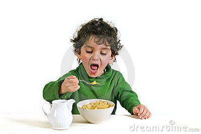 Kid eating cornflakes