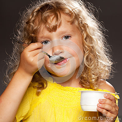 Kid eating yogurt