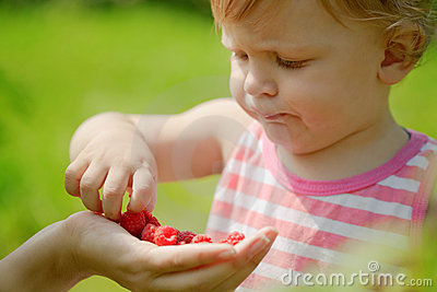 Kid Eats Raspberries Stock Photography - Image: 17789882