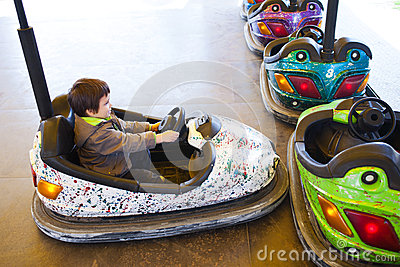 Kid in electric bumper car