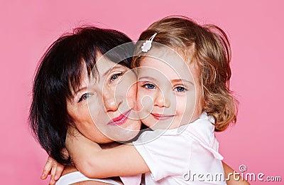 Kid embracing grandmother