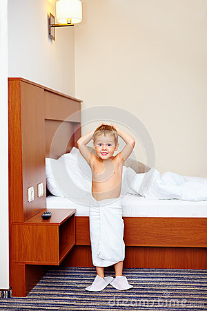 Kid enjoying hotel room after bathing