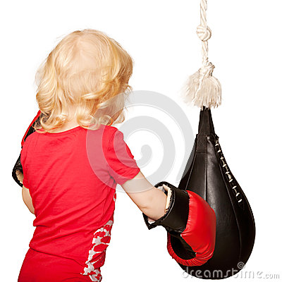 Kid exercising punching bag