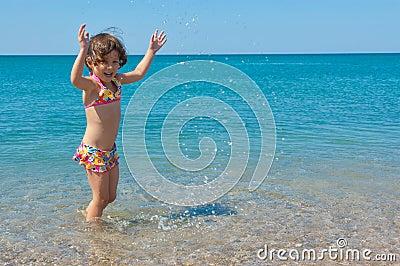 Kid on family summer beach vacation