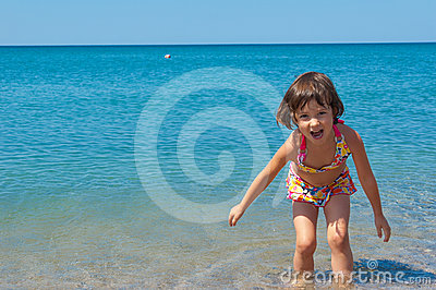 Kid on family summer beach vacation