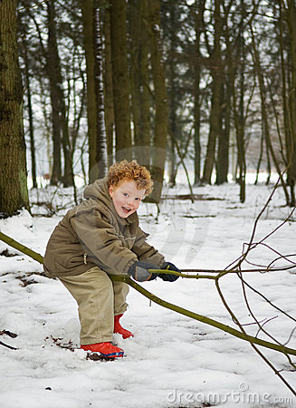 Kid in forest snow