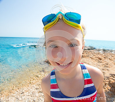 Kid funny girl wide angle beach portrait swimsuit and goggles