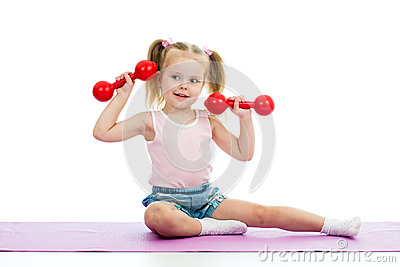 Kid doing exercises with dumbbells