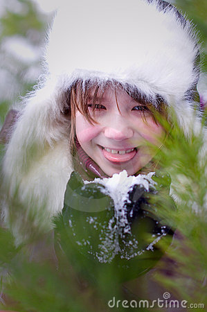 Kid girl licking snow portrait closeup
