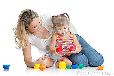 Kid girl and mother play together with toys
