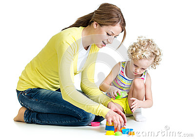 Kid girl and mother playing together