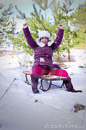 Kid girl slide toboggan hill hands up