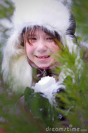 Kid girl with snow portrait closeup
