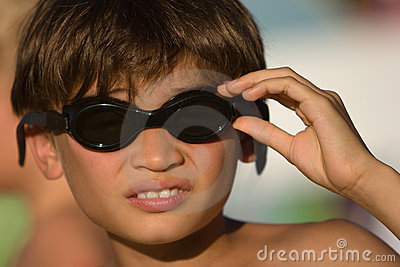 Kid with goggles ready to go for a swim