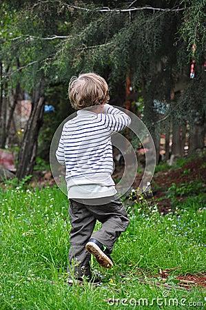 Kid on grass