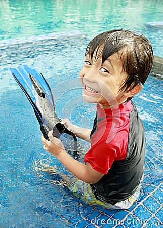 Kid having fun in the pool