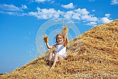 Kid in a haystack