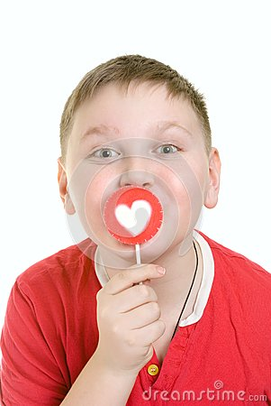 Kid with heart shaped lollipop