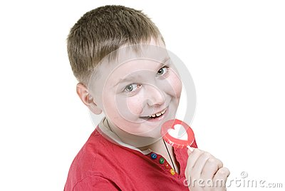 Kid with heart shaped lolly pop