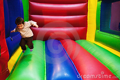Kid jumping in inflatable playground
