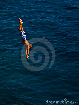 Kid jumping in the water Editorial Stock Photo