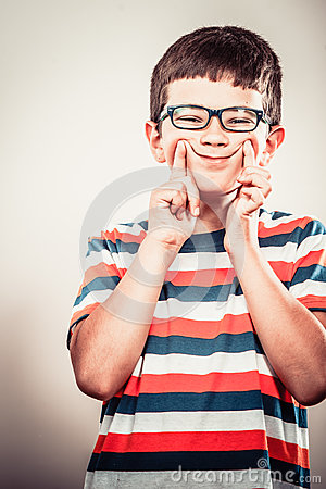 Free Kid Little Boy Making Silly Face Expression. Stock Photography - 66380032