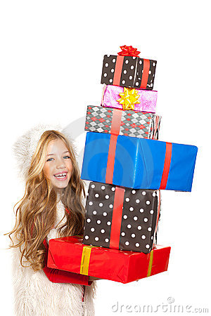 Kid little girl with christmas present stacked