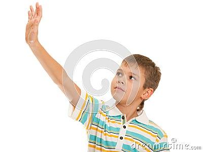 Kid looking at his risen up hand