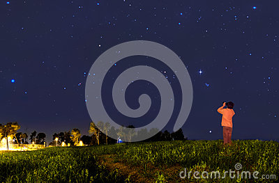 Kid looking at the stars