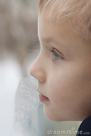 Kid looking trough the window.