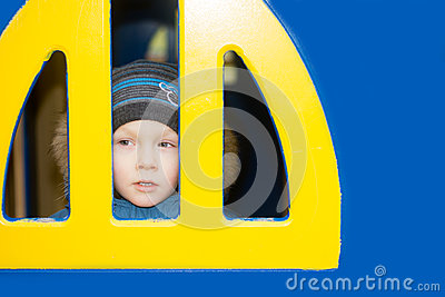 Kid looking from a window