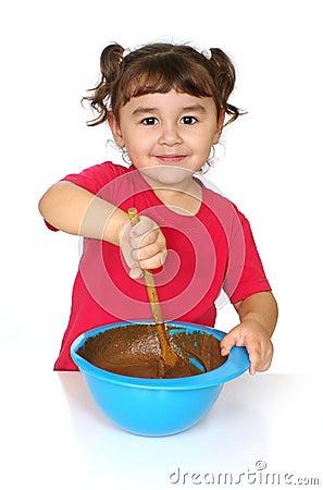 Kid mixing cake batter
