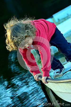 Kid playing on a boat