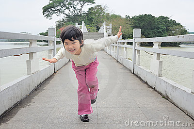 Kid playing on the bridge