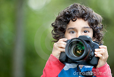 Kid playing with a camera