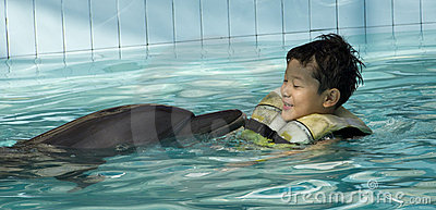 Kid playing with Dolphin