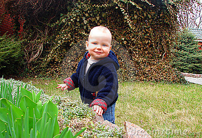 The kid playing in the garden