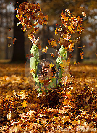 Free Kid Playing In Autumn Park Stock Photos - 23097223