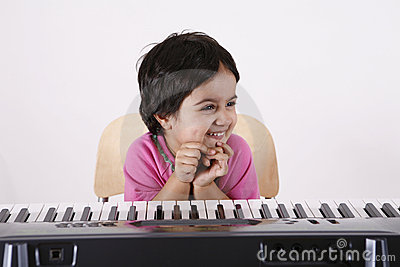 Kid playing a keyboard