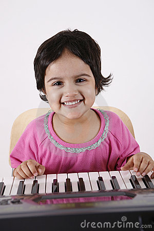 Kid playing a keyboard