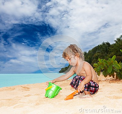 Kid playing on the seashore