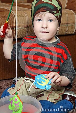 Kid plays in fishing