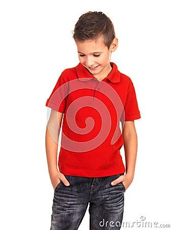 Kid posing at studio as a fashion model.