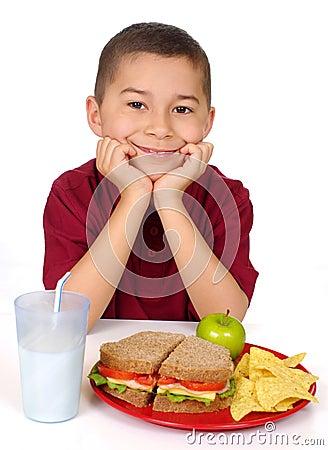 Kid ready to eat a sandwich