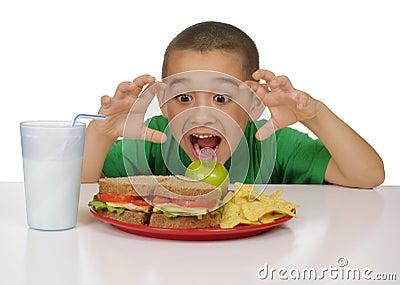 Kid ready to eat a sandwich lunch
