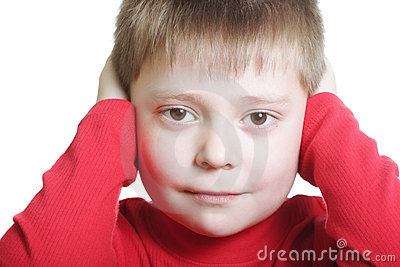 Kid in red closing ears