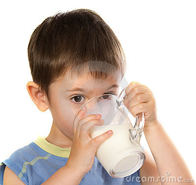 A kid s drinking some milk