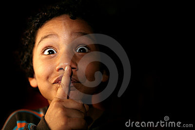 Kid with a secret or silence expression