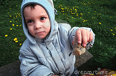 Kid showing snail