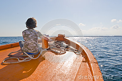 Kid sitting on a Boat